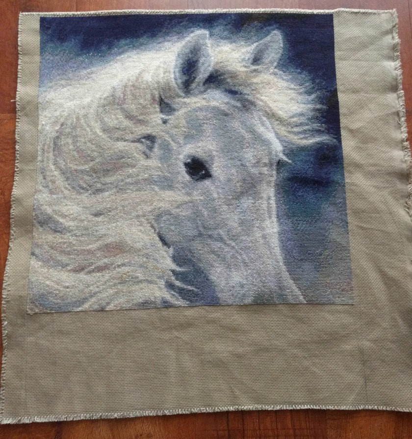 Three quarters of this image has been stitched. The nose and remaining part of the mane of the horse needs to be stitched. I may not have enough fabric to be able to stitch it all.