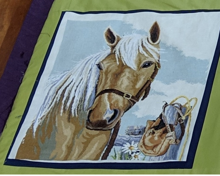 Completed Palamino. I have used this as part of a country/outback/Australiana themed  quilt. I've used a navy blue trim around it with lime green or avacado green fabric to connect it to other cross stitch pictures.